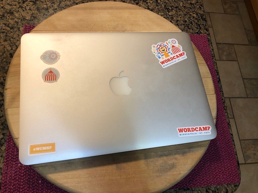 Laptop with stickers all ready for WordCamp